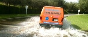 911 Restoration van driving down flooded street