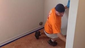 Water and Mold Damage Restoration Technician Doing Final Checks