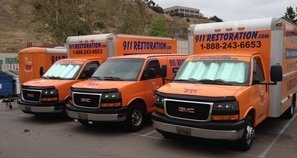 Fire Damage Restoration Fleet At Job Site