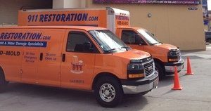 Water Damage Restoration Vans At Job Location