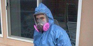 Mold Removal Technician At Job Site In Full Gear