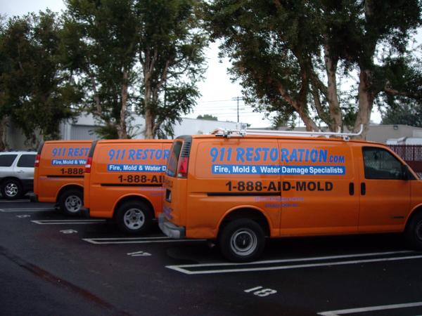 911 Restoration vans parked