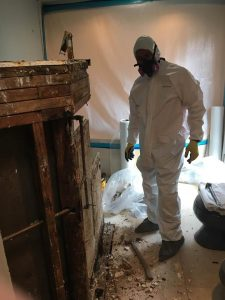 fire damage restoration crew cleans a house